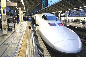 English: A Shinkansen awaiting passengers in T...