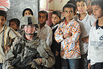 Soldiers, Iraqi national policemen distribute school supplies in Baghdad DVIDS157257.jpg