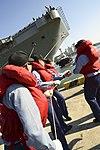 South Korean sailors secure lines as the aircraft carrier USS George Washington (CVN 73) arrives in Busan, South Korea, Oct. 4, 2013 131004-N-TB410-007.jpg