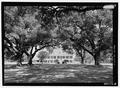 Southeast (front) elevation seen through trees - Oaklawn Plantation, Highway 494, Natchez, Natchitoches Parish, LA HABS LA-1317-5.tif