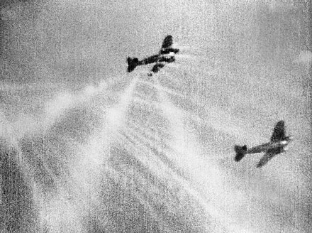 Shots from a Supermarine Spitfire Mark I hitting a Luftwaffe Heinkel He 111 (left) on its starboard quarter.