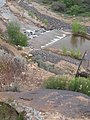 Squiggle petroglyph above dam on river dyeclan.com - panoramio.jpg