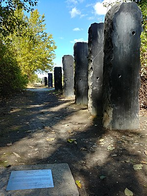 Dark stone obelisks in Magnuson Park, part of an art installation called Straight Shot