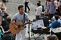 Street musician in Montmartre - guitar, Paris April 2011.jpg