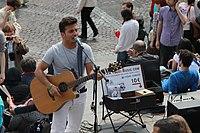 Street musician in Montmartre - guitar, Paris April 2011.jpg