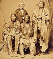Studio photograph of three Cheyenne chiefs and an interpreter (cropped).jpg