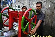 Sugarcane juice vendors in Dhaka, Bangladesh