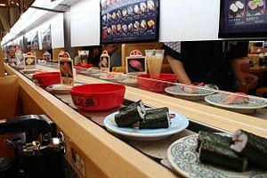 Conveyor belt sushi - Customer's view at a conveyor belt sushi restaurant.