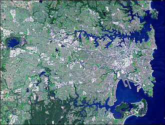 Sydney lies on a submergent coastline where the ocean level has risen to flood deep rias. Sydney ASTER 2001 oct 12.jpg