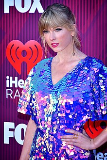 Taylor Swift arriving at the iHeartRadio Music Awards Show in March 2019