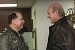 Terry Bradshaw shares a laugh with Capt. David L. Logsdon.jpg