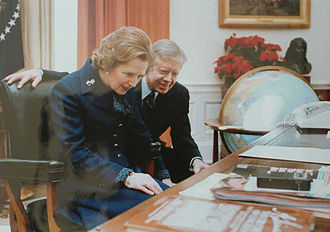 Resolute desk - British Prime Minister Margaret Thatcher reads the inscription on the front of the desk in 1979, accompanied by President Jimmy Carter.
