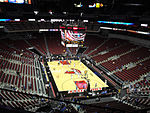 A basketball arena with a Louisville Cardinals logo at center court
