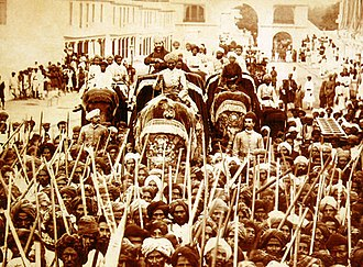 Mahbub Ali Khan, Asaf Jah VI - The Nizam riding an elephant in a procession from Moula Ali, circa. 1895