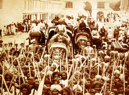 The sixth Nizam riding an elephant in a procession from Moula Ali, circa. 1890s. The Nizam VI riding an elephant in a procession from Moula Ali, circa. 1895.jpg