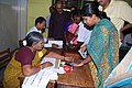 The Polling official administering indelible ink at the finger of a female voter at PSBB School polling booth of Chennai Central Parliamentary Constituency, during the 5th and final phase of General Election-2009.jpg
