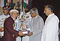 The President Dr. A.P.J. Abdul Kalam presenting Lifetime Achievement Award to Shri Nawang Gombu, under Tenzing Norgay National Adventure Award –2005 category, at a glittering function in New Delhi on August 29, 2006.jpg
