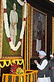 The Prime Minister, Dr. Manmohan Singh paying floral tributes at the portrait of the former Prime Minister, Late Ch. Charan Singh on his 111th birth anniversary, at Parliament House, in New Delhi on December 23, 2013.jpg