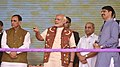 The Prime Minister, Shri Narendra Modi launching the Mobile App of Banas Co-operative Bank for e-Banking, at the inauguration ceremony of the Amul Cheese Plant and Whey Drying Pant in Palanpur, Banaskantha, Gujarat.jpg