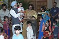 The Prime Minister Dr. Manmohan Singh with the young children who tied Rakhi to him during the auspicious occasion of 'Raksha Bandhan', in New Delhi on August 19, 2005 (1).jpg