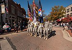 The U.S. Army Reserve Command (USARC) honor guard marches on Hay St. during the 2012 Fayetteville Veterans Day parade, Nov. 10, 2012, in Fayetteville, N.C. The annual parade featured Soldiers with the USARC 121110-A-XN107-672.jpg