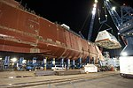 The boathouse of USS Zumwalt is moved into position. (8291330970).jpg
