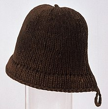 A brown hat with a rounded top and a carrying loop