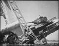The wreckage of a bridge and North Korean Communist tank south of Suwon, Korea. The tank was caught on a bridge and... - NARA - 530633.tif