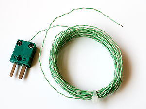 Thermocouple - Typical low cost type K thermocouple (with standard type K connector). While the wires can survive and function at high temperatures, the plastic insulation will start to break down at 300 °C.