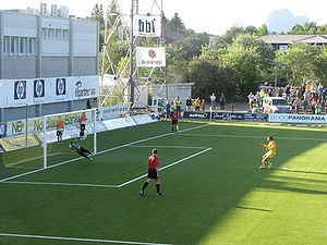 Aspmyra Stadion - Thiago Martins scoring on a penalty kick against Sogndal in a 2007 Norwegian First Division match. The west end of the stadium lacks stands.