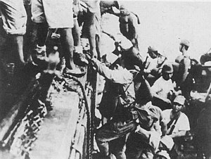 Japanese troops load onto a warship in prepara...