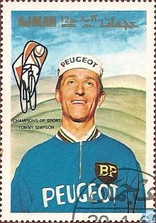Tom Simpson wearing a white cap and blue jumper, with Peugeot insignia