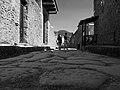 Tourists on alley in Pompeii (monochrome), 2016.jpg
