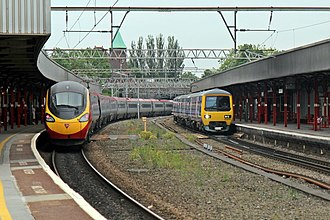 Stockport railway station - Image: Trains, 390126 and 323235, Stockport railway station (geograph 4004991)
