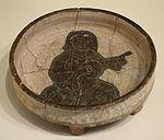 Tripod dish with seated musician, Iran, Seljuk period, 2nd half of 12th century, earthenware with black slip under transparent glaze - Cincinnati Art Museum - DSC03996.JPG