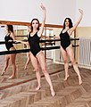 Two girls practicing in black T-front leotards.jpg