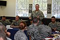 U.S. Air Force Gen. Mark A. Welsh III, standing, the chief of staff of the Air Force, speaks with Airmen at the Mosel Dining Hall at Spangdahlem Air Base, Germany, Aug. 1, 2013 130801-F-VS255-987.jpg