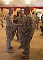 U.S. Army Maj. Gen. Robert Catalanotti, right, shakes hands with Marine Corps Gunnery Sgt. William Brooks, the company gunnery sergeant with Lima Company, Battalion Landing Team, 3rd Battalion, 2nd Marine 130429-M-HF949-003.jpg