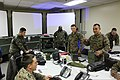 U.S. Marine Corps Lance Cpl. Steven Maldonado, right, a radio operator with Communications Company, Headquarters and Service Battalion, 3rd Marine Division, III Marine Expeditionary Force, explains the PRC-117 140312-M-BA451-520.jpg
