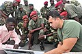 U.S. Marine Corps Sgt. Oscar G. Crespo Gallegos, right, a nonlethal weapons instructor assigned to Security Cooperation Team 6, Special Purpose Marine Air-Ground Task Force 12 120517-F-VZ366-058.jpg