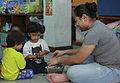 U.S. Marines, Sailors spend afternoon with children in Thailand 150610-M-TJ275-061.jpg