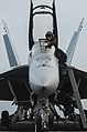 U.S. Navy Aviation Electronics Technician 3rd Class Jesse Fox, assigned to Strike Fighter Squadron (VFA) 154, cleans the canopy of an F-A-18F Super Hornet aircraft on the flight deck of the aircraft carrier USS 130816-N-ZG290-034.jpg