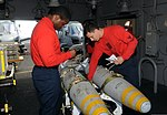 U.S. Navy Aviation Ordnanceman 1st Class Terry Miller, left, and Aviation Ordnanceman 2nd Class Luke Legaspi inspect training ordnance aboard the aircraft carrier USS George H.W. Bush (CVN 77) in the Atlantic 130813-N-MU440-033.jpg