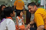 U.S. Navy Chief Quartermaster Andrey Mihaylovski interacts with children at Child at Street 11 during a USS Blue Ridge 130610-N-NN332-077.jpg