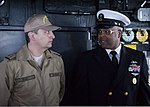 U.S. Navy Command Master Chief Albert McCurdy, right, speaks with Romanian Navy Warrant Officer Daniel Pap on the bridge aboard the guided missile destroyer USS Truxtun (DDG 103) in Constanța, Romania, March 8, 2 140308-N-EI510-011.jpg