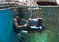 U.S. Navy Diver 2nd Class Andrew Bui, with Space and Naval Warfare Systems Center Pacific, recovers an autonomous underwater vehicle (AUV) built by students from Cornell University after navigating through an 130724-N-TM257-008.jpg
