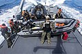 U.S. Navy Petty Officer 2nd Class John A. Wilcox, center, a maritime interdiction operations expert, and members of a Seychelles Coast Guard boarding team prepare to board a simulated target vessel Nov. 13 131113-N-EZ054-033.jpg