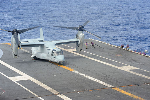 U.S. Sailors move into position to refuel a Marine Corps MV-22 Osprey tiltrotor aircraft on the flight deck of the aircraft carrier USS George Washington (CVN 73) during Operation Damayan in the Philippine Sea 131117-N-XN177-028
