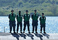 U.S. Sailors stand at attention aboard the attack submarine USS Jacksonville (SSN 699) as the submarine arrives for maintenance in Apra Harbor, Guam, April 9, 2013 130409-N-LS794-035.jpg