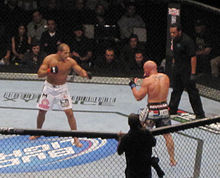 Junior dos Santos, in white shorts, and Shane Carwin, in black shorts, during an MMA match at the main event of UFC 131 in Vancouver, British Columbia, on June 11, 2011.
